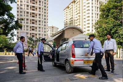 security guards conduct a security check on a vehicle