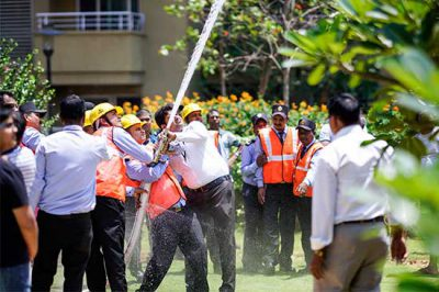 security guards holding a hose and spraying water