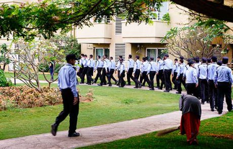 group of security guards walking in a lawn